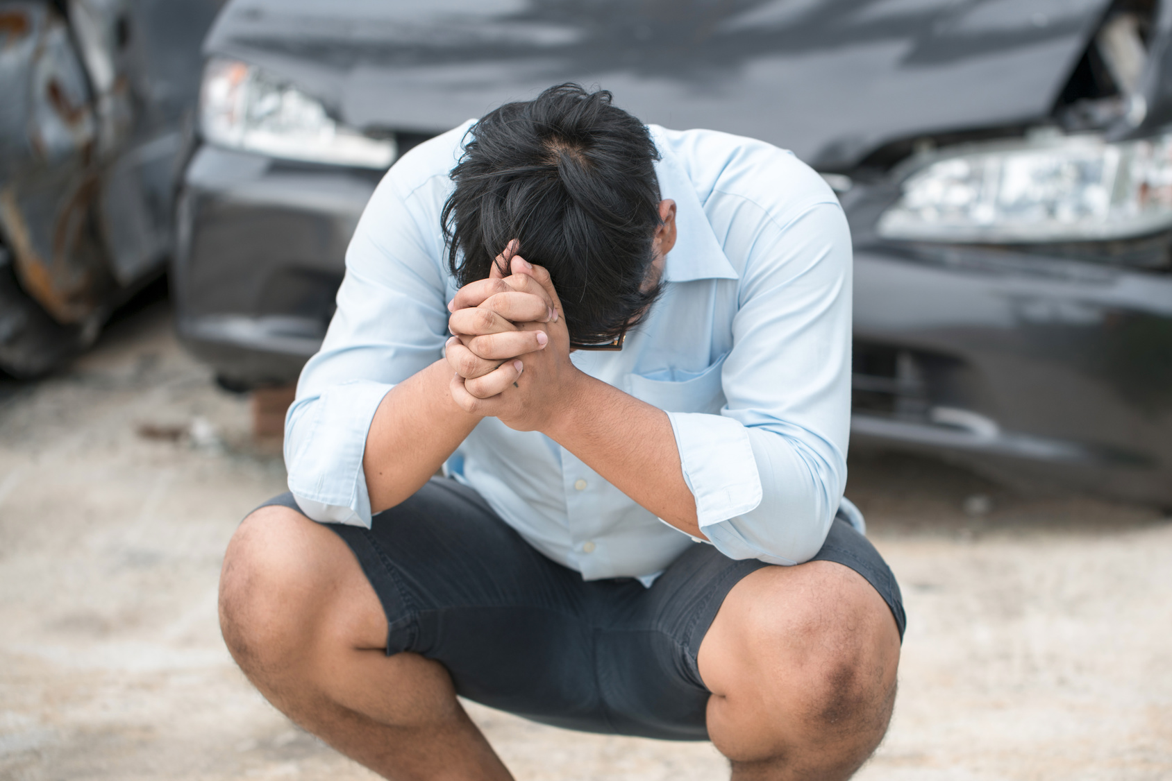 praying guy by crashed car-immediate.jpg